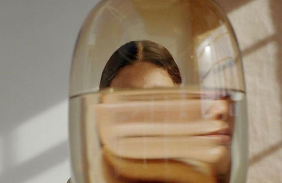 A photo of a woman distorted by water