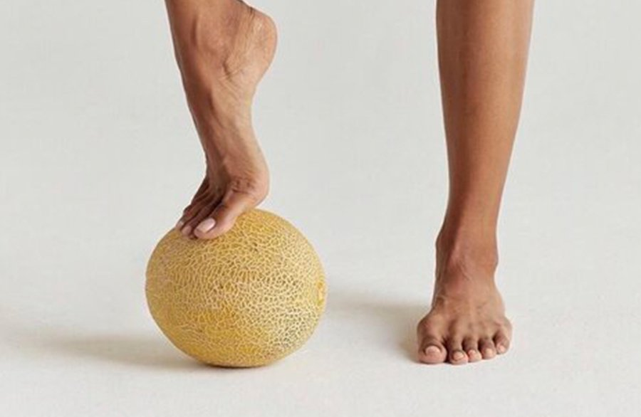A person with a melon on his feet