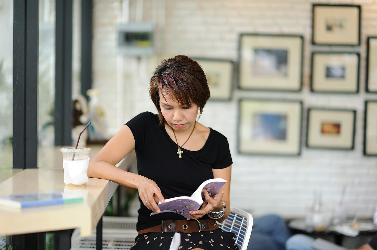 Woman reading about endometriosis
