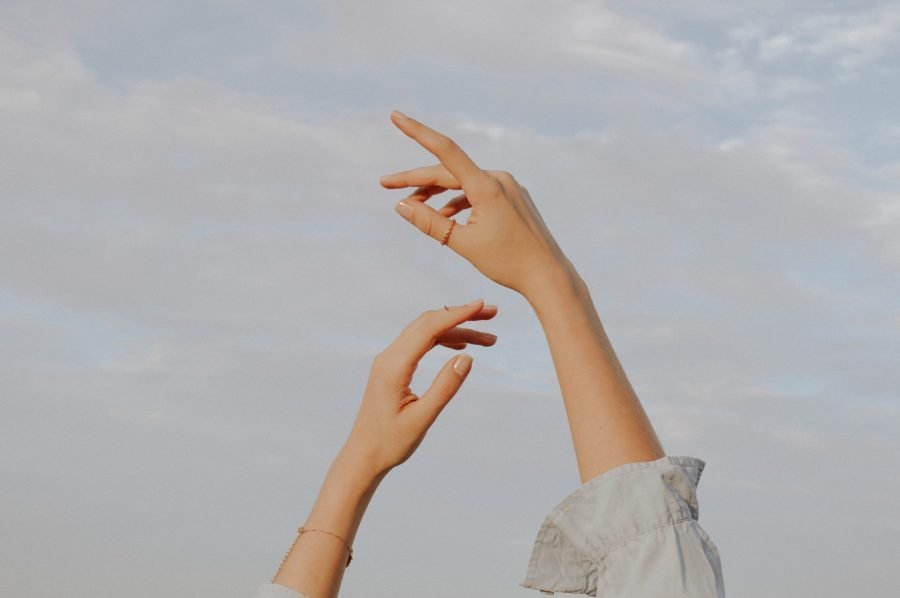 Woman raising her hands to the sky