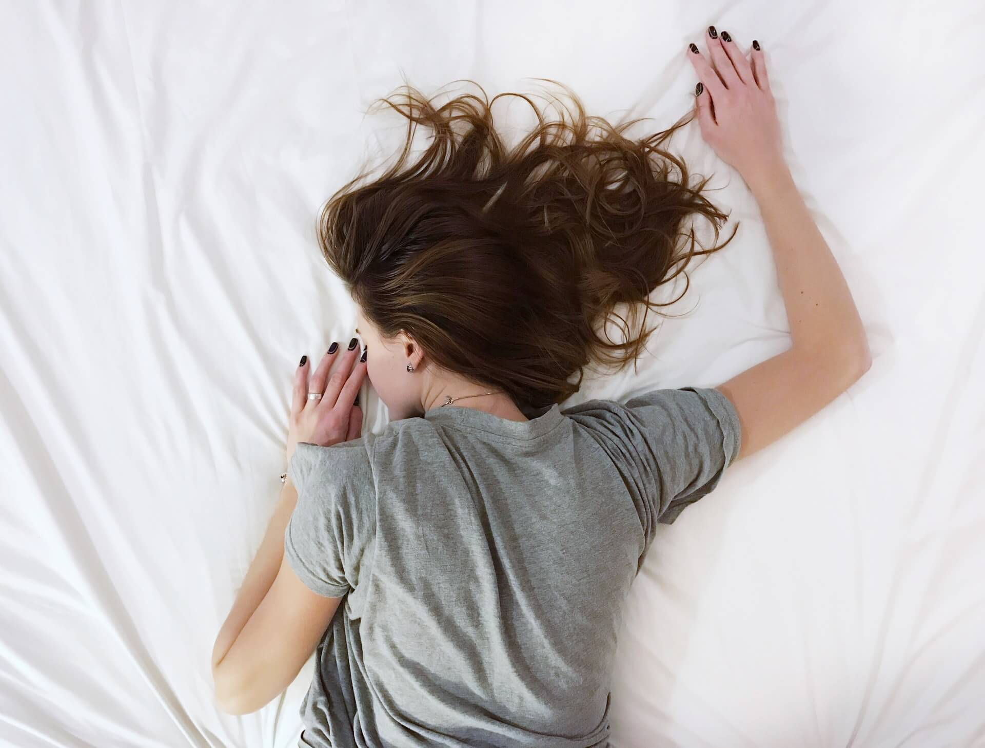 Simptoms of PMS. Pain in woman
