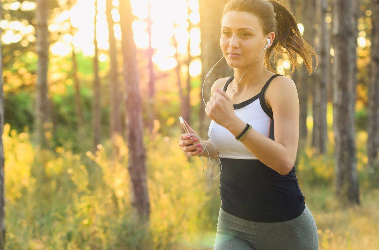 woman exercising to increase fertility