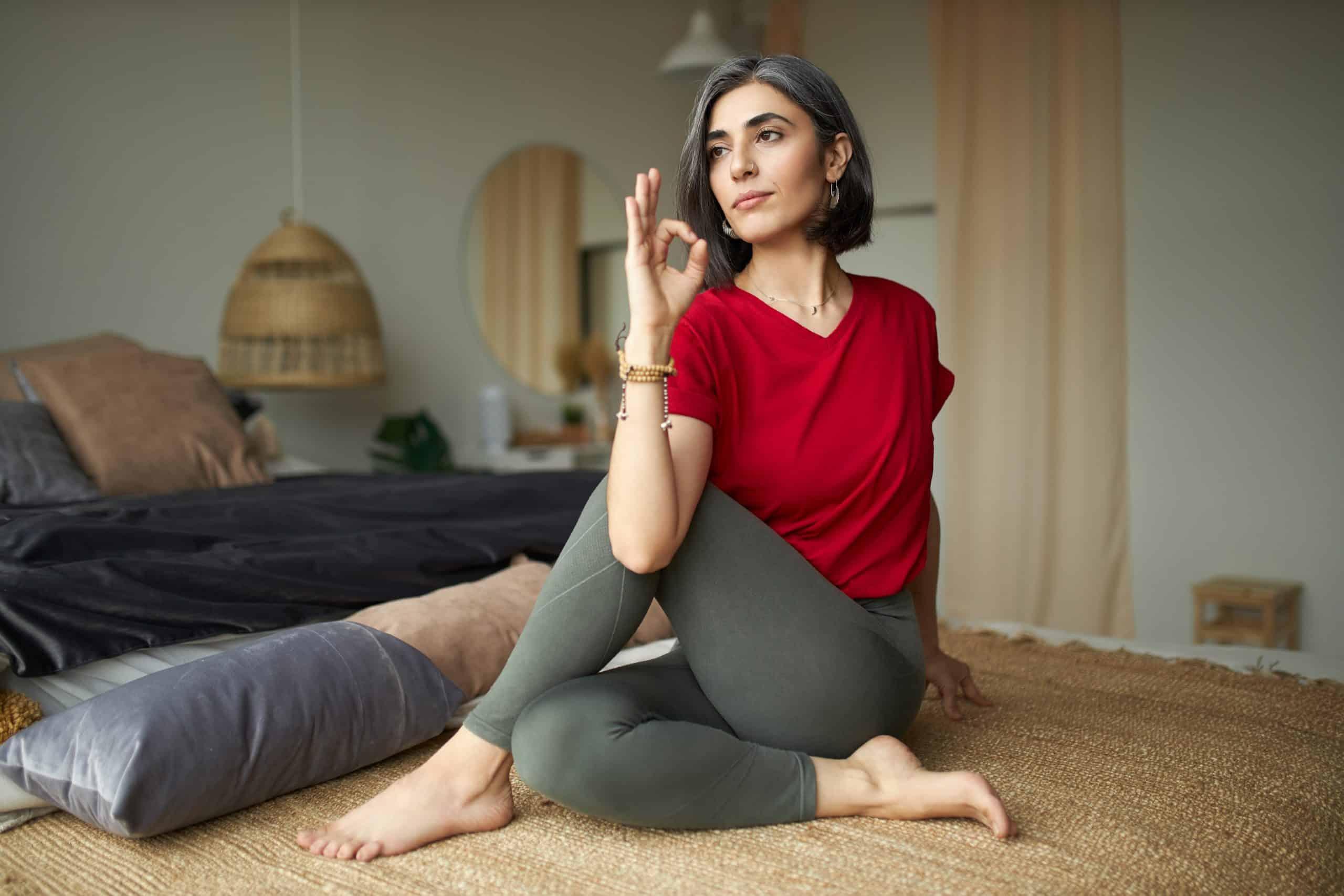 young woman practicing yoga ardha matsyendrasana